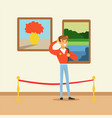 young tourist man standing in art gallery in front vector image vector image