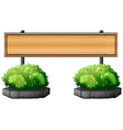 An empty signboard above the plants vector image vector image