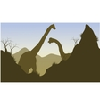 Silhouette of brachiosaurus behind the cliff vector image vector image