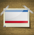 Flags Crimea at frame on a brick background vector image