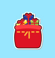 red santa bag with gift boxes icon isolated cute vector image