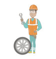 young hispanic mechanic with tyre and spanner vector image vector image