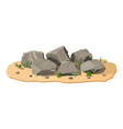 pile of rock stone with grass on sand vector image