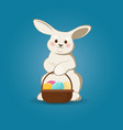 cute easter bunny with easter eggs basket vector image