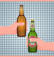 hand holds a wet beer bottle vector image