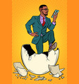 the businessman was born from an egg reads news vector image vector image