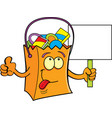 cartoon trick or treat bag holding a sign vector image vector image