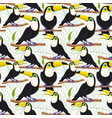seamless pattern with birds toucans on branches vector image vector image