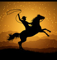 silhouette of cowboy with lasso on rearing horse vector image vector image