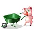 A pig holding a wheelbarrow vector image vector image