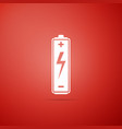 battery icon isolated on red background vector image vector image