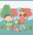 girl and boy with alphabet blocks in city park vector image vector image