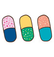 three colorful pills on white background vector image vector image