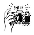 man hand holding camera on white background vector image vector image