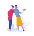 girls holding phone friends posing for selfie vector image