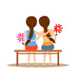 back view two cute girls hugging together on vector image vector image