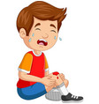 cartoon little boy crying with scraped knee vector image