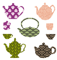 Tea pots and cups with Asian pattern vector image