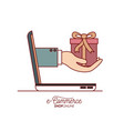 laptop with hand holding a gift side view e vector image