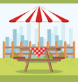 picnic table with umbrella outdoor scene vector image