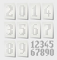dotted numbers punched on white paper vector image