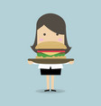 businesswoman carrying a big hamburger vector image