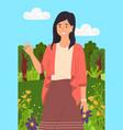 beautiful girl in a summer garden near flowerbed vector image