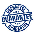 guarantee blue round grunge stamp vector image vector image