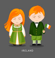 irish in national dress with a flag vector image vector image