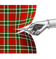 womans hand with scissors cutting tartan fabric vector image
