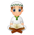 boy read quran the holy book of islam vector image vector image