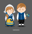 swedes in national dress with a flag vector image vector image
