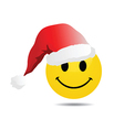 Smiley face with santa hat vector image