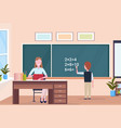 woman teacher sitting at desk schoolboy solving vector image vector image