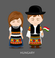 hungarians in national dress with a flag vector image vector image