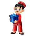 muslim kid holding red gift box wearing red clothe vector image vector image
