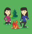 two friends sitting around bonfire in camping vector image vector image