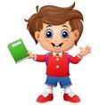 School boy holding a book