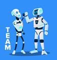team two robots give five to each other vector image vector image