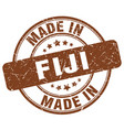 made in fiji brown grunge round stamp vector image vector image