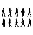 silhouette men and women walking on white vector image vector image