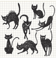 hand drawn black cats in different poses