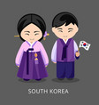 koreans in national dress with a flag vector image vector image