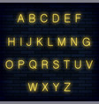 yellow neon alphabet on blue brick background vector image