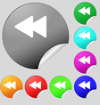 rewind icon sign Set of eight multi-colored round vector image vector image