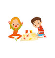cute little boy and girl sitting on the floor and vector image vector image