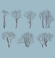 silhouettes of trees without leaves with snow vector image vector image
