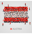 large group of people in the austria flag shape vector image vector image