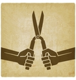 worker hands with shears old background vector image vector image