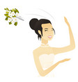 young asian bride tossing a bouquet of flowers vector image